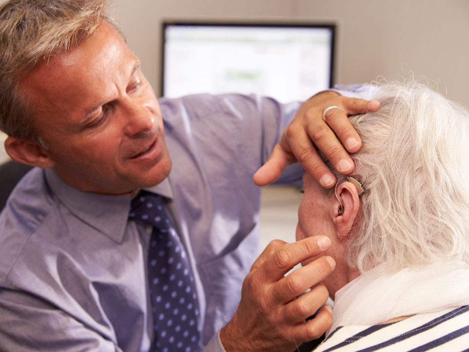 man-being-fitted-with-hearing-aid